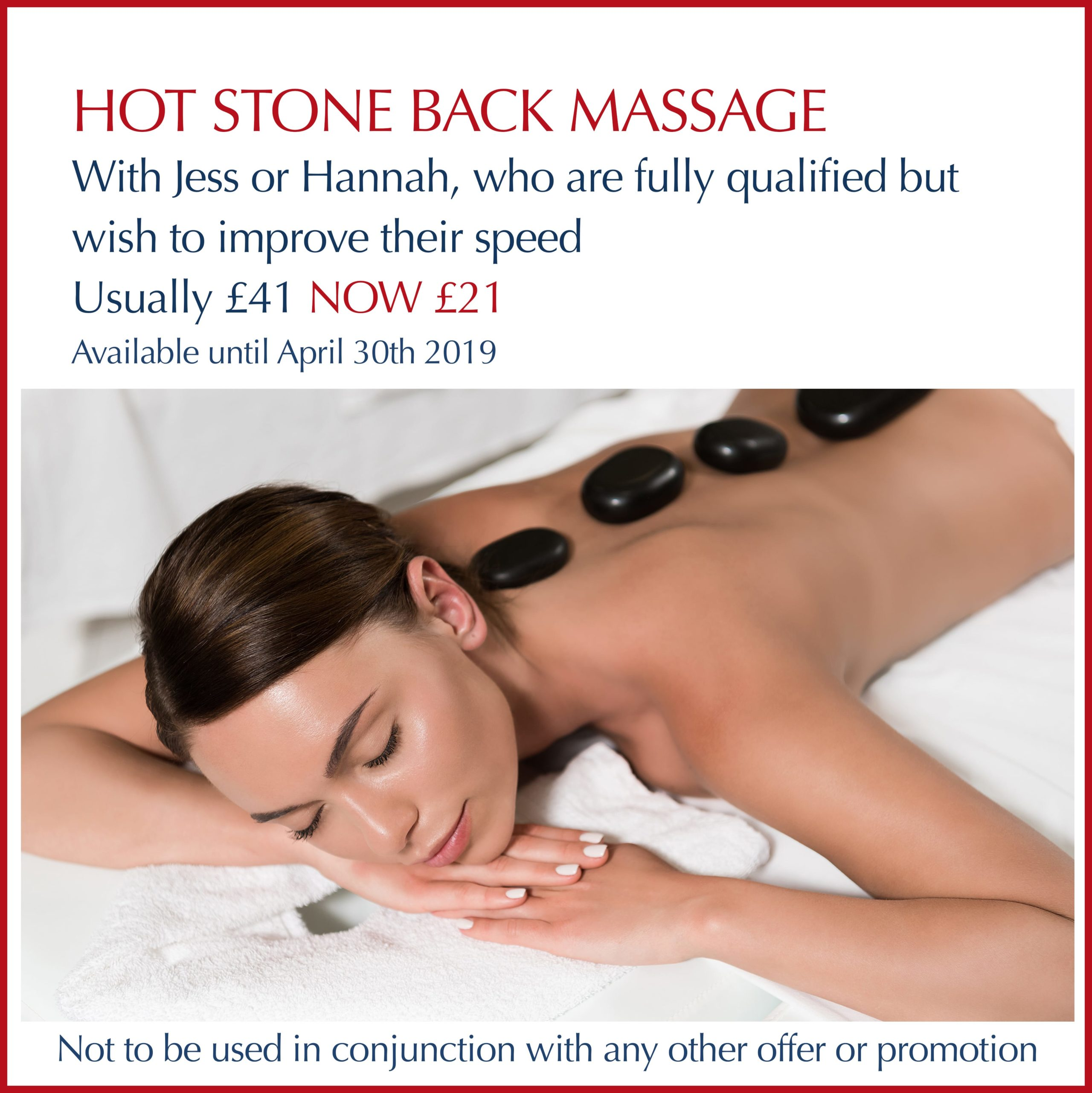 Lady lying on treatment bed with hot stones on her back