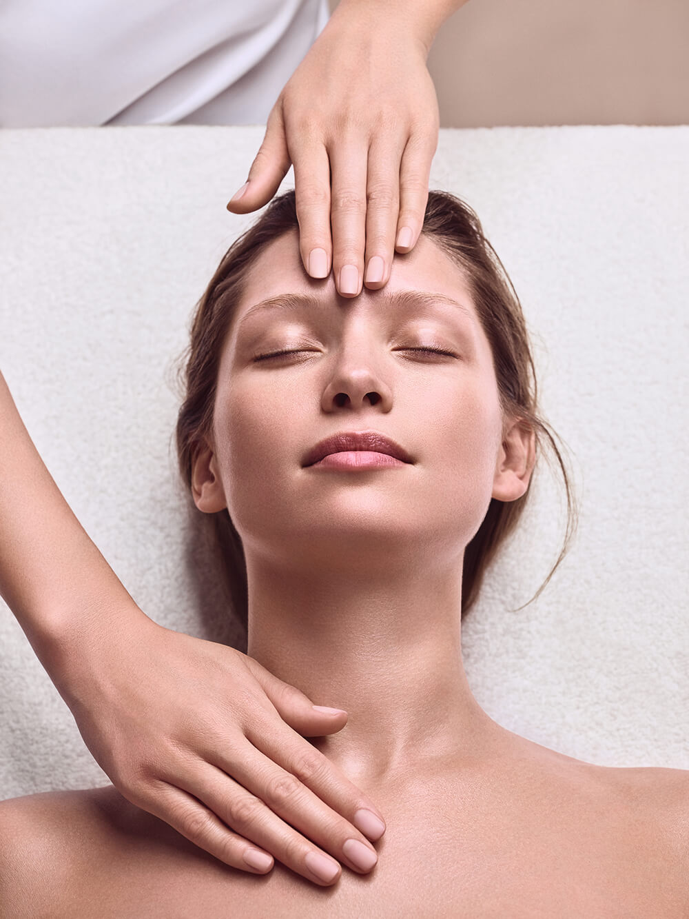 lady in spa having Clarins Facials