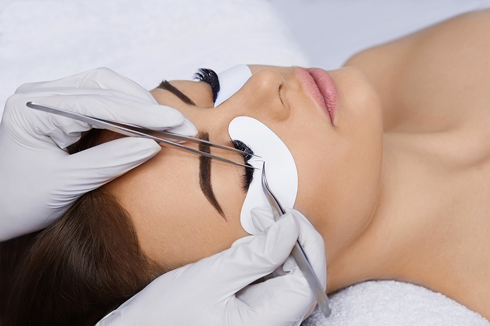 Applying Classic Lashes (Individual Lash Extensions) to a lady at a spa
